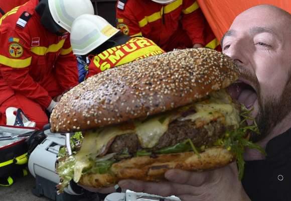Mania burgerilor! Mulţi români sună la descarcerare pentru că le rămâne burgerul blocat în gură
