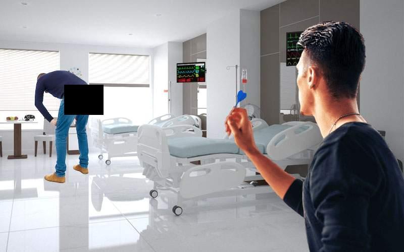 Campion la darts, angajat de un spital să facă injecţii de la distanţă