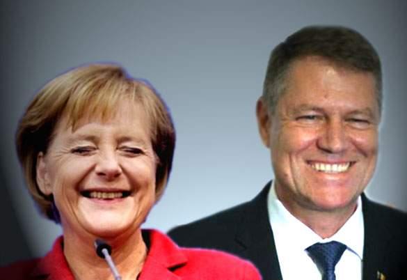 Zeci de fotografi berlinezi, cu obiectivul crăpat după ce Iohannis şi Merkel au zâmbit simultan