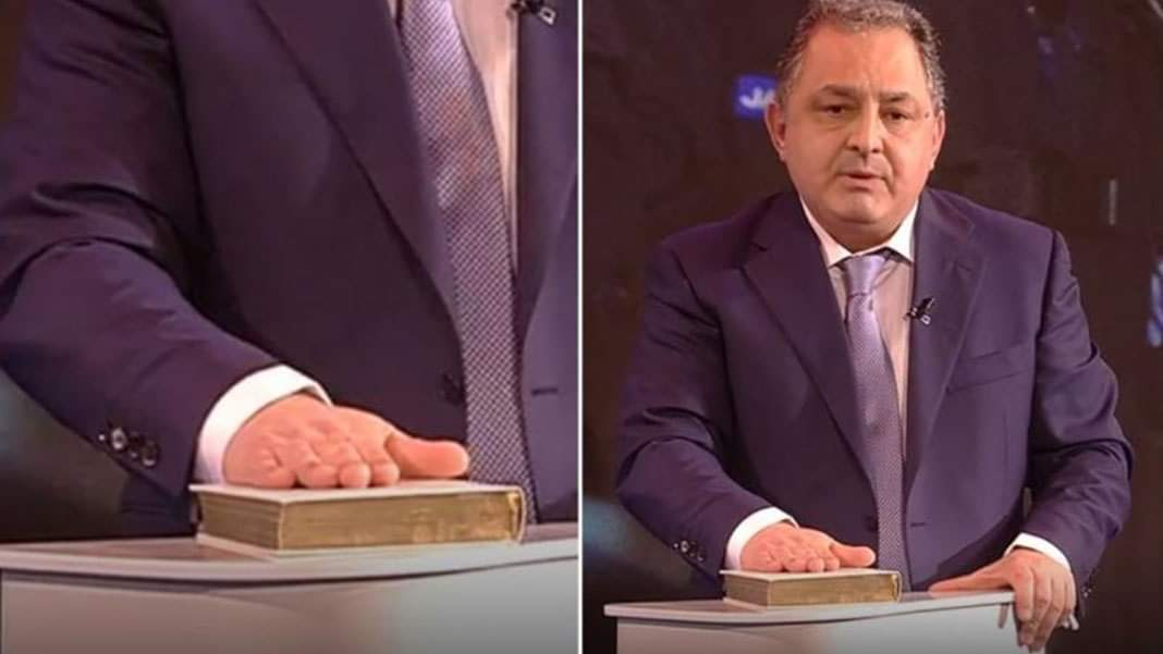 Vanghelie, prins încercând să fure o Biblie în direct la televizor