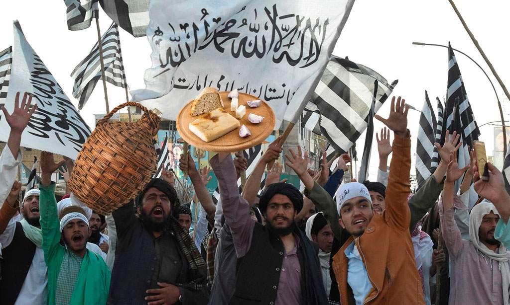 Talibanii renunță la Islam după ce au găsit țuică şi slană în ambasada României